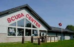 Scuba Center in Eagan, Minnesota: Our Eagan dive shop location has one of the largest selections of drysuits, dry gloves, and drysuit diving accessory equipment in the Upper Midwest. We are proud to serve Eagan and the surrounding Minnesota cities including: Apple Valley, Burnsville, Cottage Grove, Farmington, Inver Grove Heights, Lakeville, Maplewood, Oakdale, St. Paul, West St. Paul, Woodbury,… | Just minutes from the Mall of America and the Minnesota Vikings Headquarters | Scuba Diving classes and diving equipment in Minnesota | Get a map and directions to Scuba Center | 1571 Century Point Eagan, Minnesota 55121 | Photo: Scuba Center